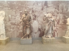 The one the middle is believed to be the statue of a philosopher thought to be Plutarch or Plato.