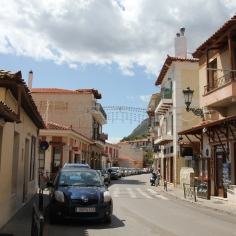 The streets of Delphi lined by local shops and restaurants.